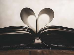 A book with pages folded into the shape of a heart.