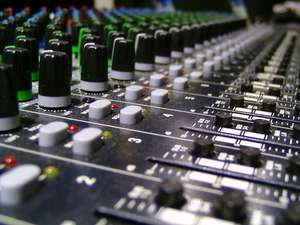 A professional audio mixing board.