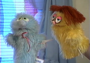 A clip from Jenny and the Fuzzy Avengers, where you can clearly see arms in the puppets.